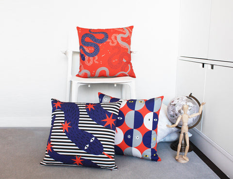 printed pillows snakes interior design