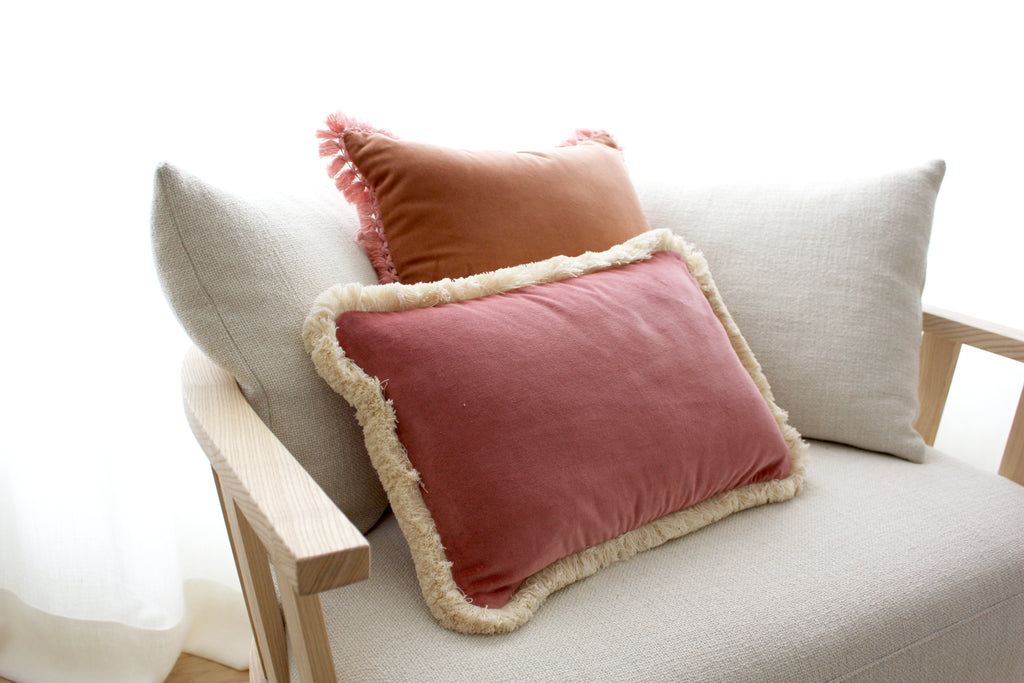 A welcoming scenario for Spring with pink velvet cushions.