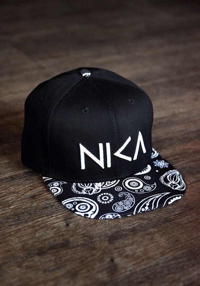 NIKA with Brim Pattern Snapback Hat