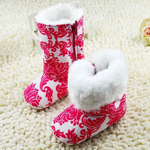 Pink floral patterned boots with soft lining and zip