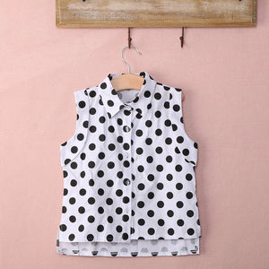 Polka dot shirt with pink shorts