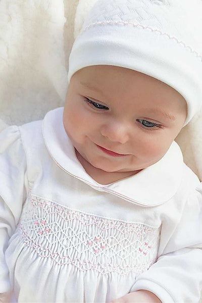 The softest Baby bodysuits made of pima cotton and hand embroidered details by Nella Pima