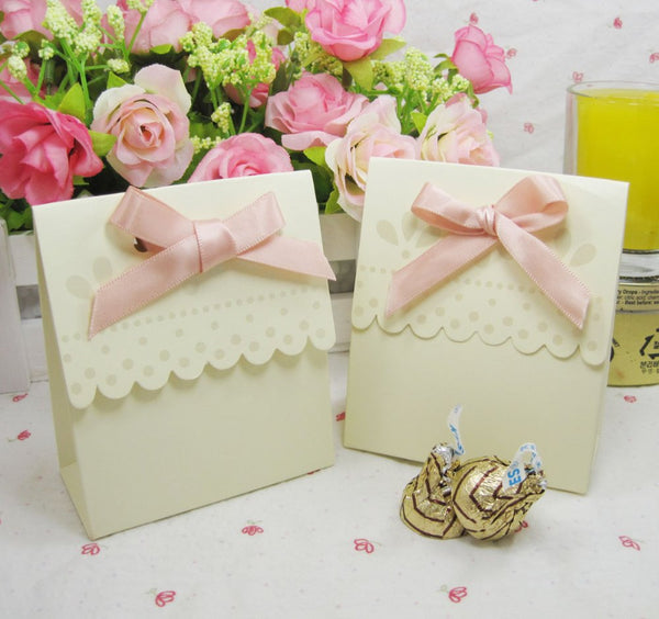 New Arrival 100pcs Ivory cream color wedding favor box with pink ribbon