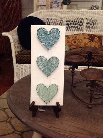 3 teal hearts with white background