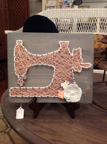 Pink sewing machine string art