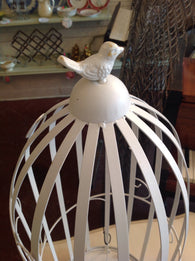 Beautiful, white metal birdcage.  Great for candles, plants, or even create your own chandelier.