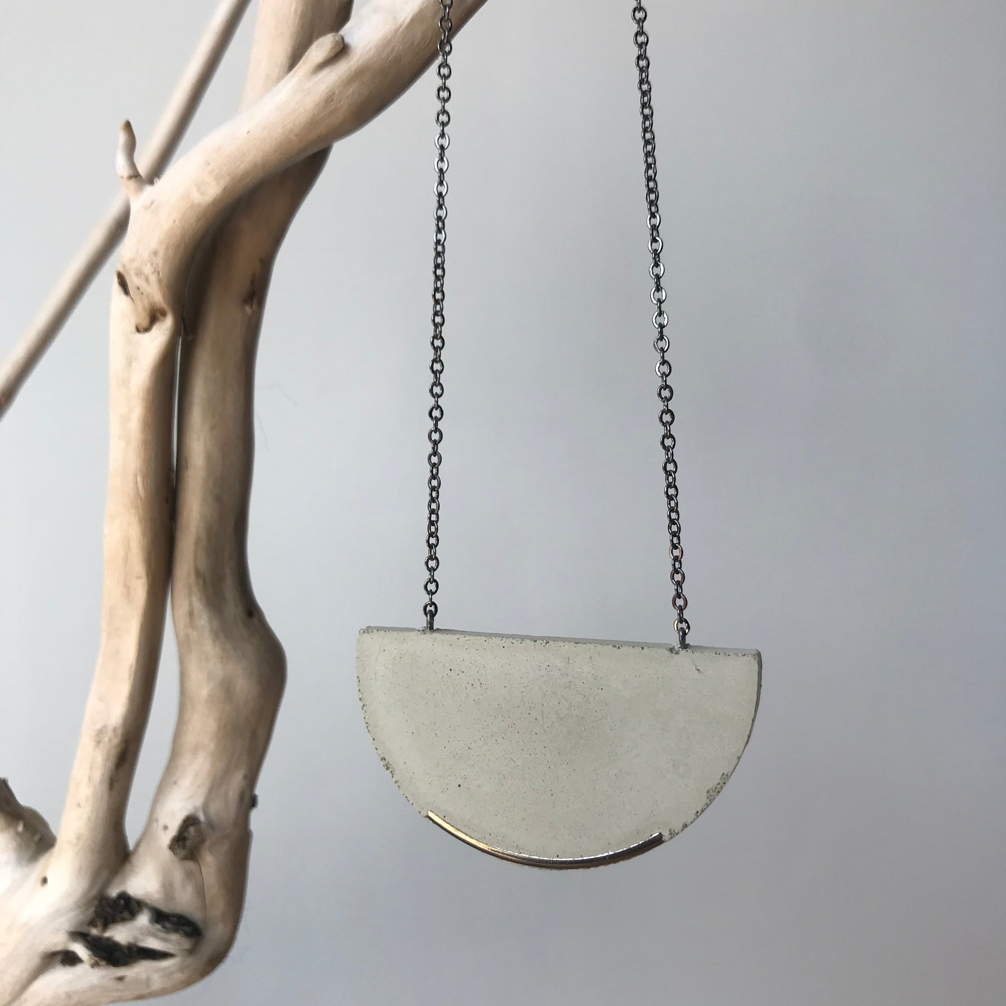 Concrete Half Moon Necklace with Embedded Silver Edge by Koonyai Studio - Upstate MN