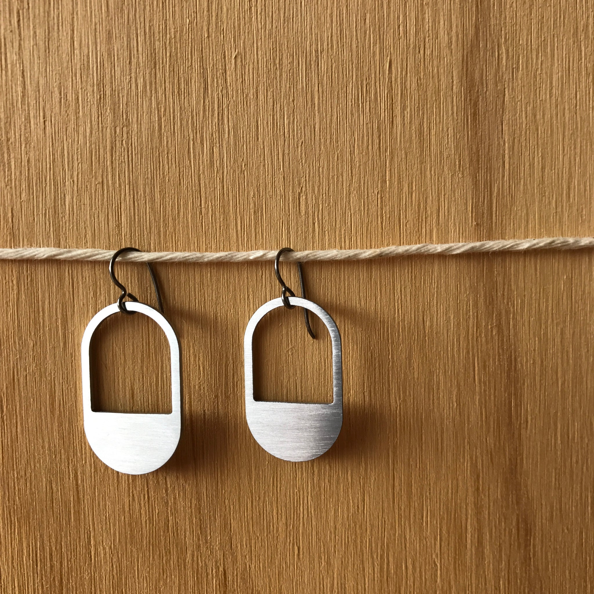 The Dangle Capsule Stainless Steel Hook Earrings by Days of August