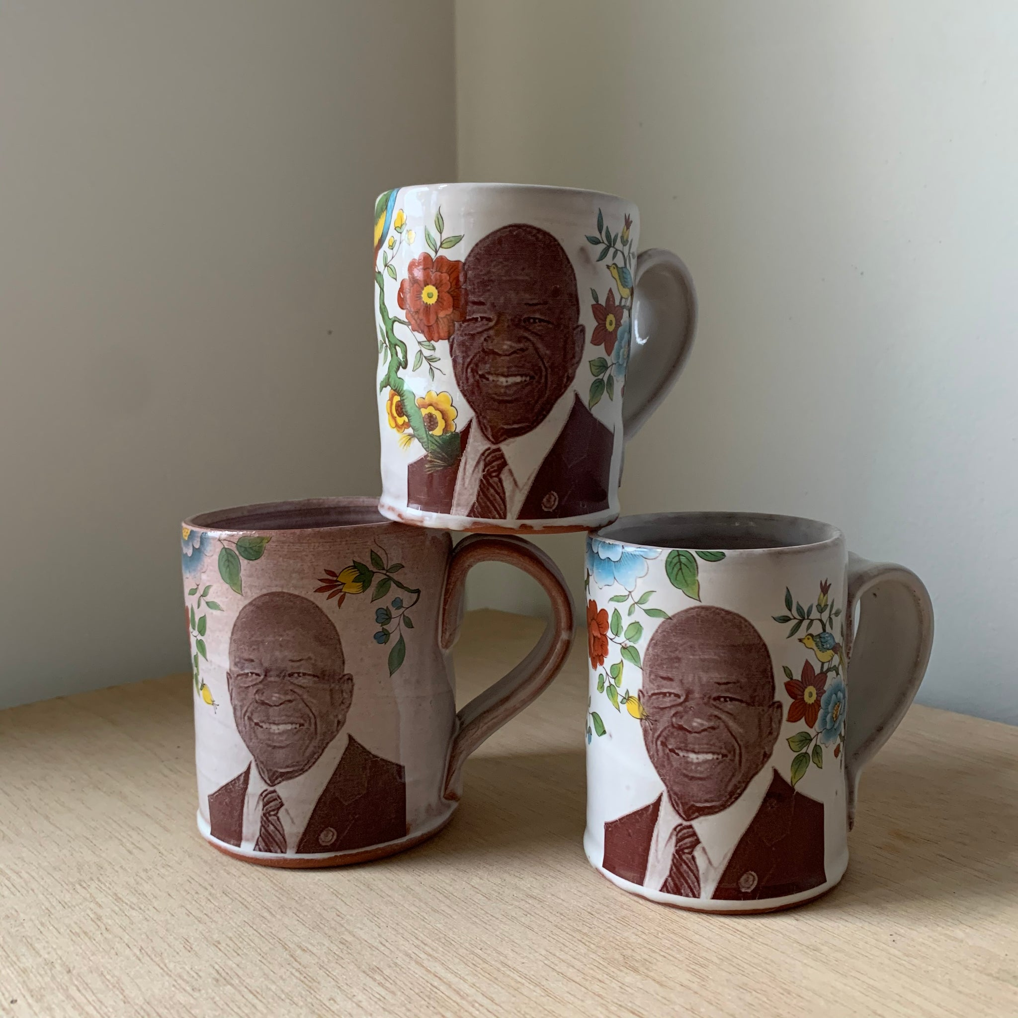 Elijah Cummings Floral Decorated Ceramic Mug by Justin Rothshank