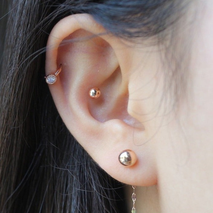 Single cubic huggie earring