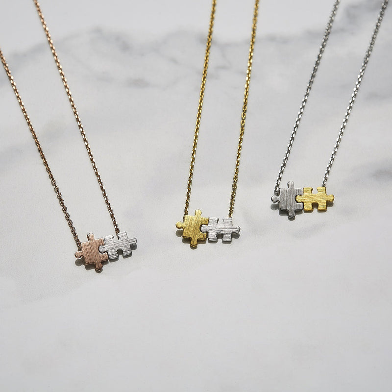 Two tone puzzle necklace