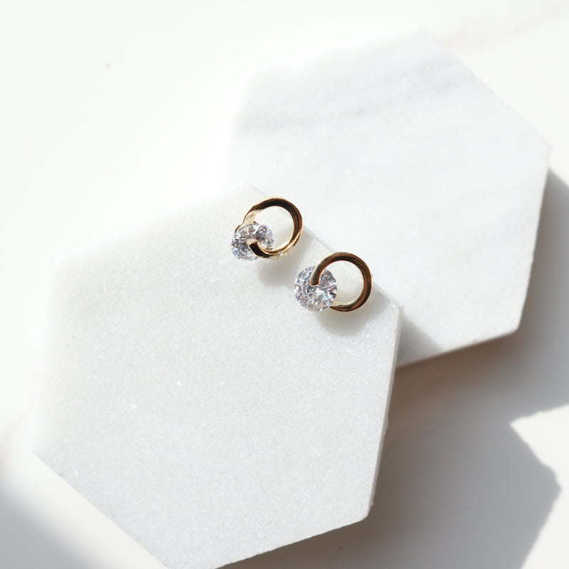 Cubic circle spins earrings