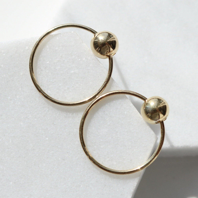 Ball with line circle earrings