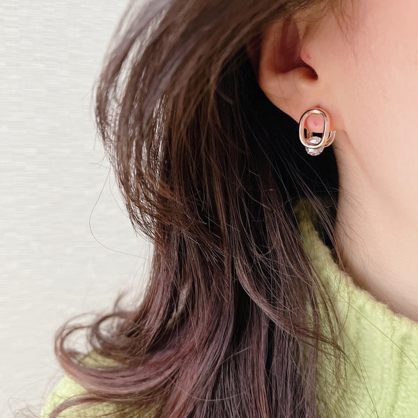 Cubic oval huggie earrings