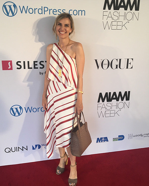 Yara Bashoor at Miami Fashion Week 2017 wearing a sustainable ostrich handbag tote called the Adam in light brown