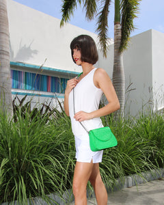 Model with Green Crossbody Ostrich Benny Bag in Deco Building Miami
