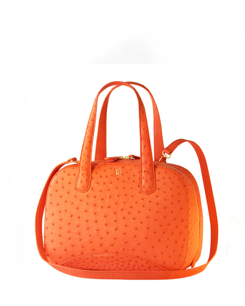 True Orange Ostrich Genuine Sustainable Large Charles Tote Yara Bashoor Angle view with Long Strap Attached