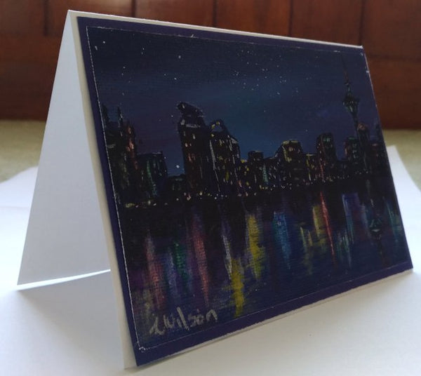 city at light lights on the water hand painted greeting card by Goldstarwork, artist Laura Wilson