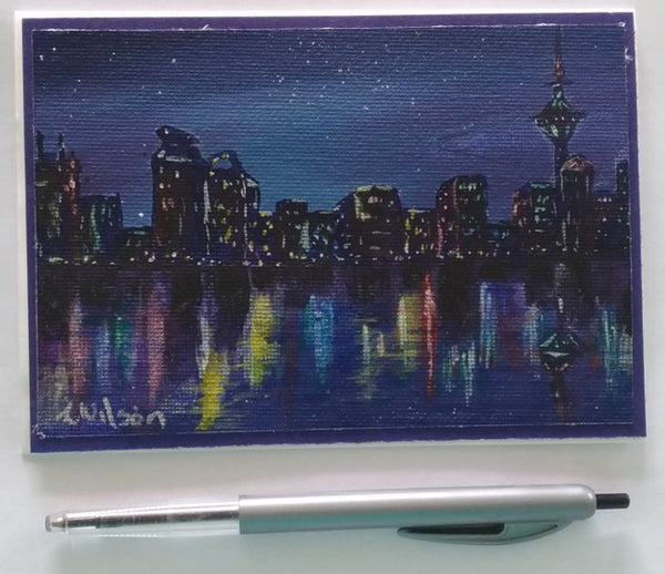 city lights reflecting on the water hand painted greeting card by Goldstarwork, artist Laura Wilson