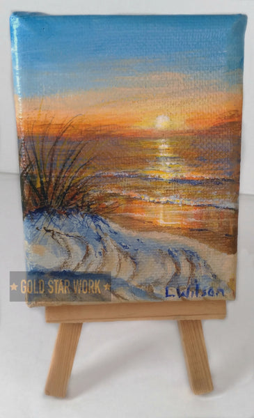 Small acrylic painting orange sunrise seascape, on stand. By Goldstarwork, Artist Laura Wilson