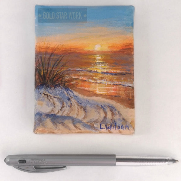 Small acrylic painting orange sunrise seascape, showing size. By Goldstarwork, Artist Laura Wilson
