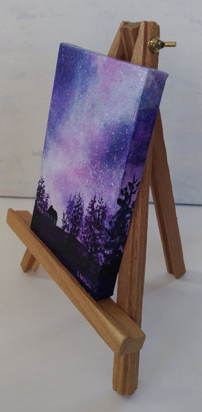 Acrylic painting, purple starry night sky by Goldstarwork artist Laura Wilson. Left side view small painting