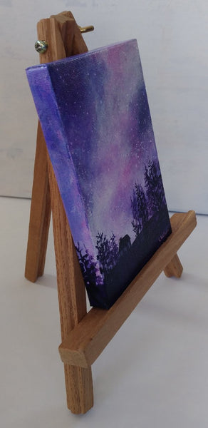 Acrylic painting, purple starry night sky by Goldstarwork artist Laura Wilson. right side view mini painting