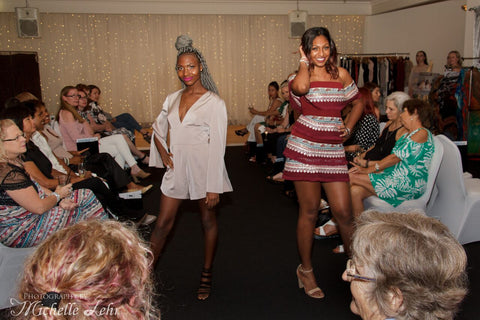 Models on catwalk in fashion clothing