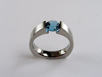 Round Titanium Tension Set Ring in Brushed Finish with a Round London Blue Topaz Gemstone
