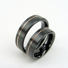 Load image into Gallery viewer, Black Wedding Ring Set in Zirconium Metal with an Offset Rose Gold Pinstripe