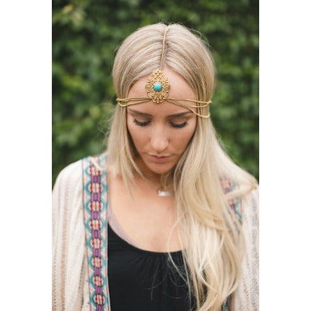 Gold chain head chain featuring intricate gold cut-out headpiece with center turquoise stone, with adjustable clasp.