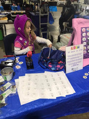 Arianna selling buttons
