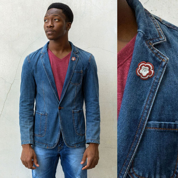 Man Wearing a Stylish Chelsea Boutonniere in Rich Red & White on a Denim Jacket