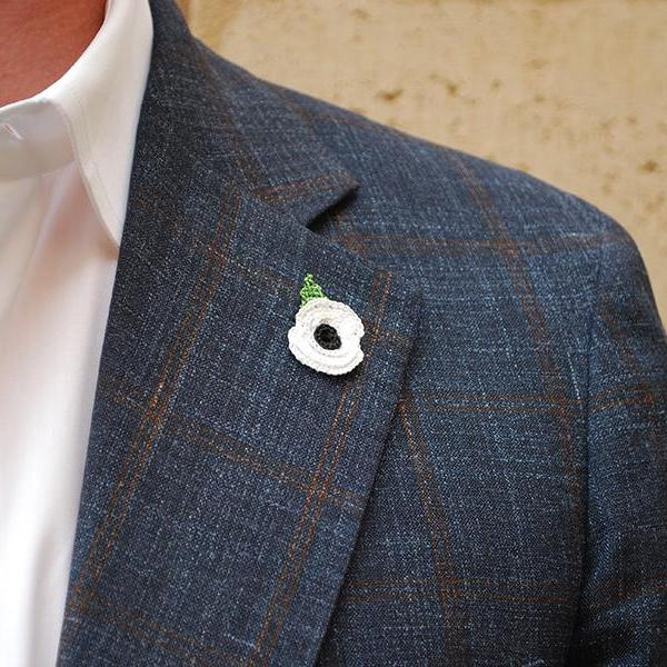 Poppy Boutonniere in White with Leaf on Suit