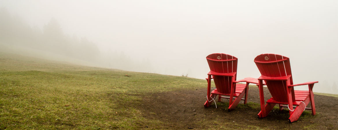 two red chairs in the mist