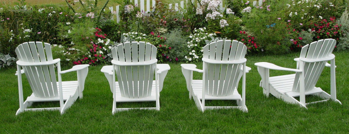 4 white chairs in a garden