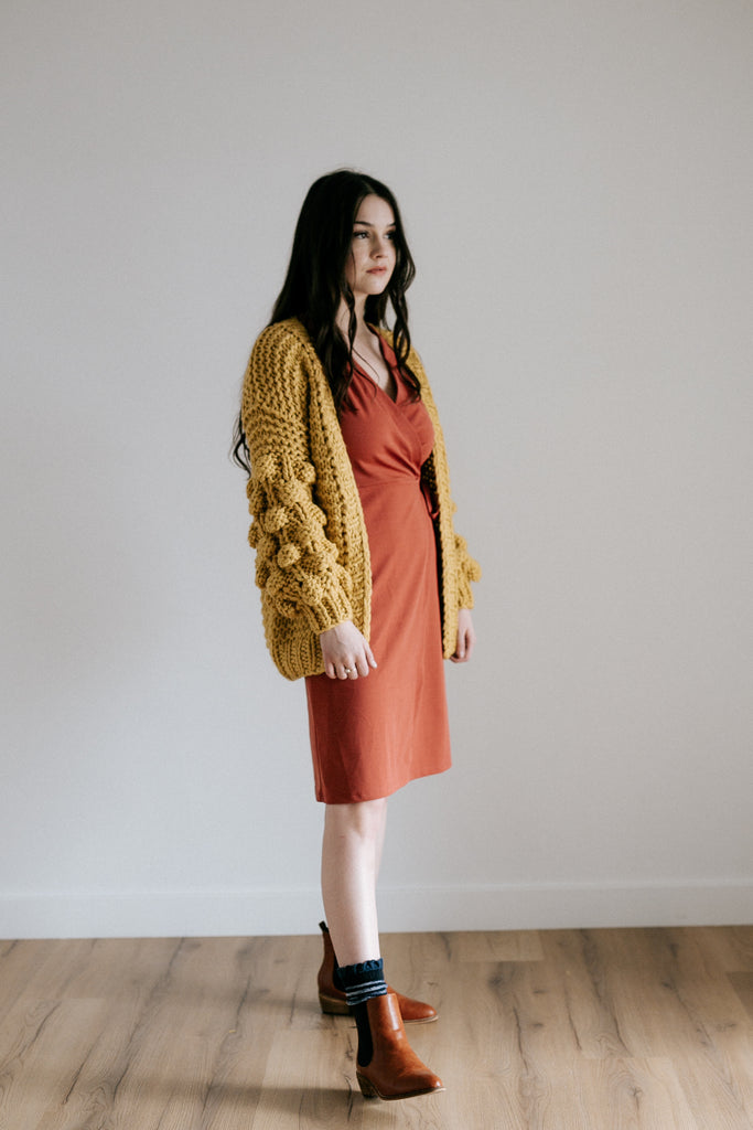 schrute pom pom sweater in mustard