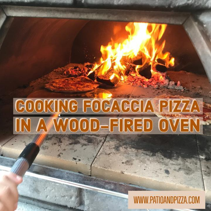 Cooking a Focaccia Pizza in a Wood Burning Oven