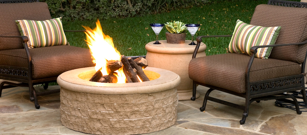 Propane Firepit with flames sitting between two rocking chairs