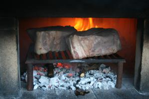 Grill for wood-fired oven