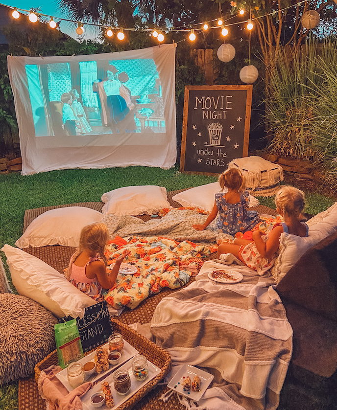 Family outdoors watching movie