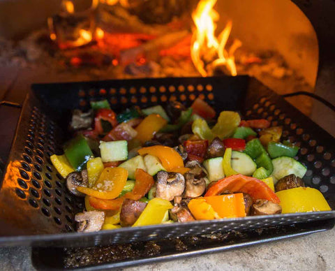 Vegetables cooking in a wood fired brick oven