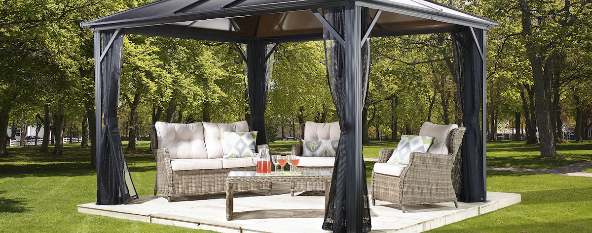 Gazebo Kit outside with patio furniture underneath