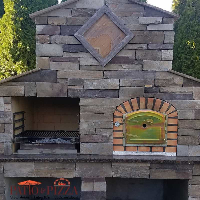 Brick mediterranean pizza oven built beside a fireplace