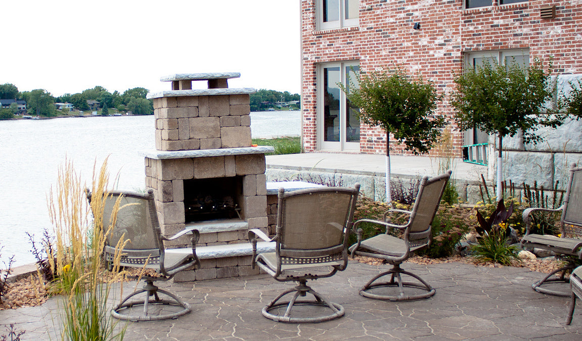 Outdoor compact fireplace beside the lake