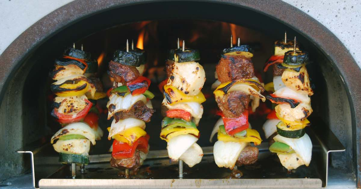 Cooking kabobs in a wood burning oven