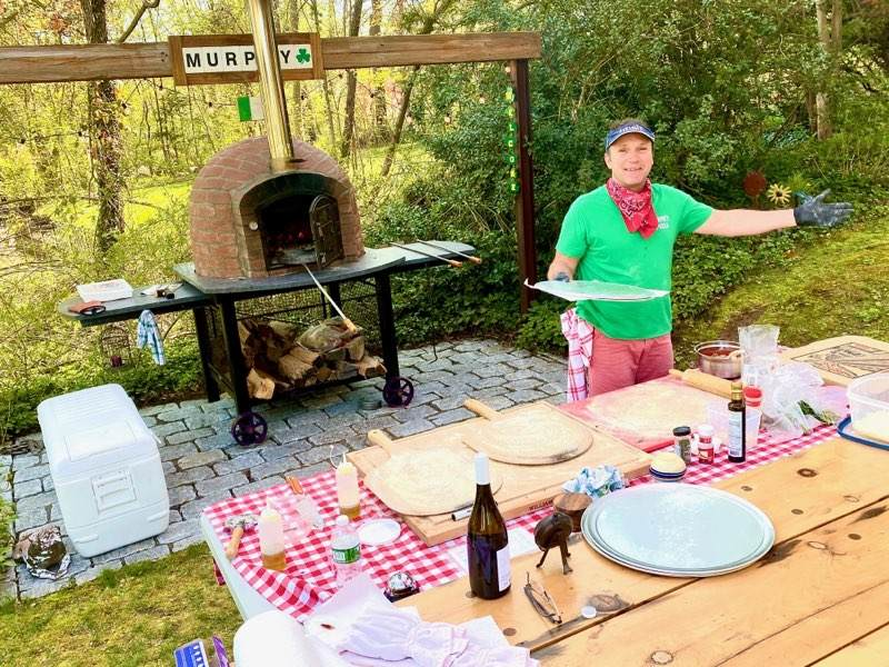 Baking pizzas in an authentic brick pizza oven