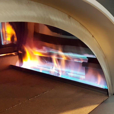 Gas pizza oven showing burners
