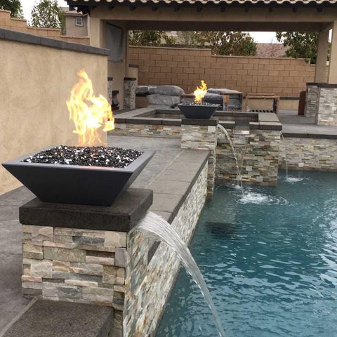 Image of Two pool fire bowls with flames and water