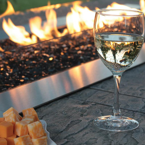 Image of Wine and cheese sitting on table with Empire Carol Rose Fire Pit